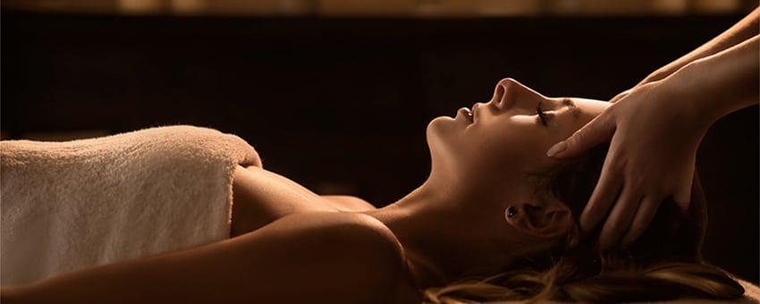 Young woman enjoys massage